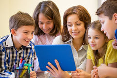 Group of kids with teacher and tablet pc at school royalty free stock photography