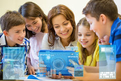 Group of kids with teacher and tablet pc at school royalty free stock photos