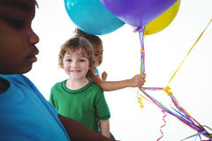 Group of kids together with balloons Royalty Free Stock Photo
