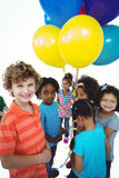 Group of kids together with balloons Stock Photo
