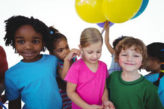 Group of kids together with balloons Stock Images