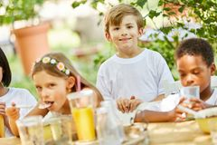 Group of kids together at breakfast. Group of kids together having breakfast in international kindergarten Stock Photo