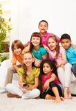 Group of kids with TV remote controll Stock Image