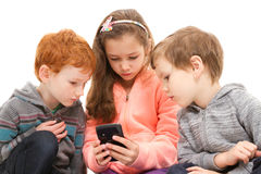Group of kids using smartphone. Group of kids using black smartphone. Isolated on white Royalty Free Stock Images