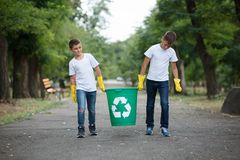 Group of kids volunteer help garbage collection charity environment, selective soft focus. Team work. Recycling a plastic bottle. Recycle a plastic bottle in a Royalty Free Stock Images
