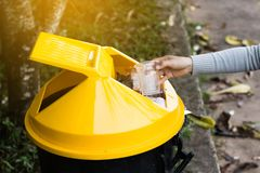 Group of kids volunteer help garbage collection charity. Stock Photos