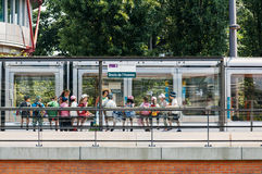 Group of kids waiting tram at Human Rights Station Royalty Free Stock Image