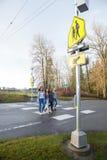 Group of kids walking across school crosswalk Royalty Free Stock Images