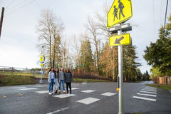 Group of kids walking across the school crosswalk. Group of young girl friends with cultural diversity Royalty Free Stock Photos