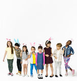 Group of Kids Wearing Bunny Ears for Easter Happiness Smiling on White Background stock photos
