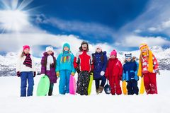 Group of kids and winter activities Stock Photos