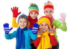Group of kids in winter clothes. Group of kids in bright winter clothes, isolated on white Stock Photos
