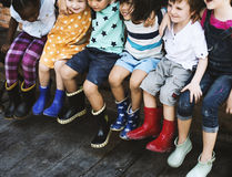 Group of kindergarten kids friends arm around sitting and smilin Royalty Free Stock Photo