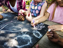 Group of kindergarten kids friends drawing art class outdoors royalty free stock images