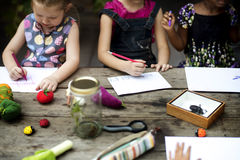 Group of kindergarten kids friends drawing imagination art on th. E paper royalty free stock photo