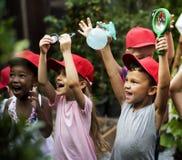 Group of kindergarten kids learning gardening outdoors Royalty Free Stock Photos