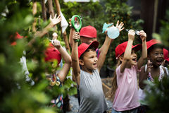 Group of kindergarten kids learning gardening outdoors Stock Image