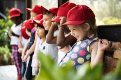 Group of kindergarten kids learning gardening outdoors field tri Royalty Free Stock Photos