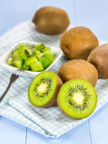 Group of kiwi fruit (cut up and whole). On the wooden table Stock Photos