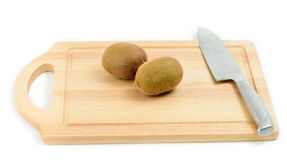 Group of kiwi fruit on wooden block Stock Photography