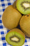 Group of kiwis. Fruits isolated on the kitchen table stock images