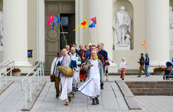 Group of Krishnas goes on Cathedral Square of Vilnius Stock Photos