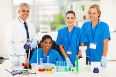 Group lab technicians. Group of happy medical lab technicians in laboratory stock images
