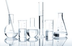 Group of laboratory flasks with a clear liquid Stock Image