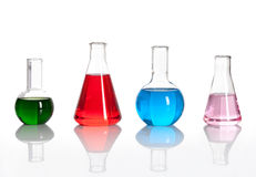Group of laboratory flasks with a colored liqiuds. Group of laboratory flasks with a colored reagents, isolated royalty free stock photo