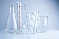 Laboratory glassware on table, Symbolic of science research. Stock Photography