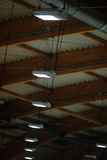 Group of lamps on sport stadium celling. Light power energy Royalty Free Stock Photo