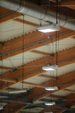 Group of lamps on sport stadium celling. Light power energy Stock Photography