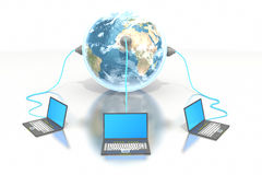 Group of laptop computers hook up to the Earth. A group of laptop computers hook up to the planet earth in a global network concept.  On a white background with Royalty Free Stock Photo