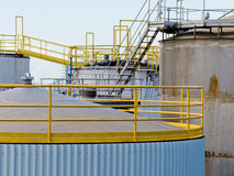 Group of large steel storage tanks at refinery Royalty Free Stock Photos