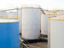 Group of large steel storage tanks at refinery Royalty Free Stock Images