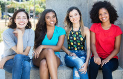 Group of latin and caucasian girl with young african american an. D hispanic women outdoor in the summer in the city royalty free stock photo