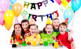 Group of laughing kids having fun at the birthday party. Stock Image