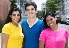 Group of laughing latin american and caucasian women and man Stock Photos