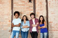 Group of laughing multiethnic young men and women indoor with co royalty free stock photo