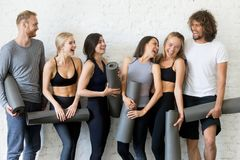 Group of laughing young sporty people Stock Images