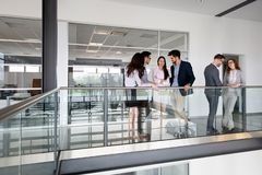 Group of lawyers discussing contract together in office Royalty Free Stock Photography