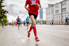 Group leaders athletes runners race. Ekaterinburg, Russia - August 6, 2017: group leaders athletes runners race in Europe-Asia Marathon stock photography