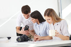 Group learning in photo workshop. How to handle camera and lenses Royalty Free Stock Image