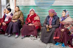 The group of Leh woman sitting in front of the entrance to the monastery royalty free stock image