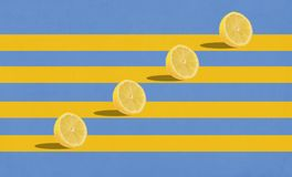 Group of lemons in air on blue background stock image