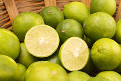 Group of Lemons in a Basket. Stock Photo