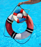 Group of life buoy on water. Royalty Free Stock Photos