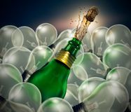 Group of light bulbs green glass sparkling wine bottle Royalty Free Stock Image