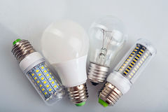 Group of light bulbs. Old generation bulb, Tungsten bulb, and white energy saving bulb Royalty Free Stock Photo