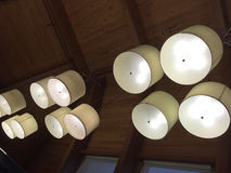 Group of light fixtures hanging at the ceiling Royalty Free Stock Images